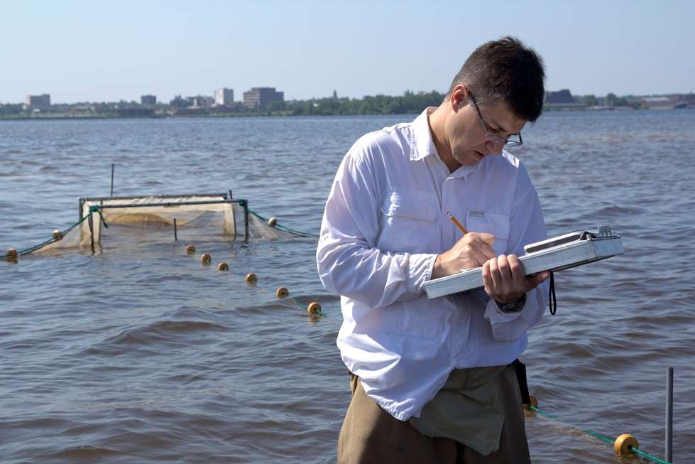 Carl Ruetz recording data in Muskegon Lake